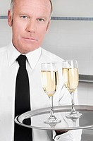 Waiter holding a tray of champagne flutes