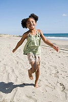 Girl running on a sandy beach