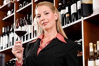 Businesswoman holding a glass of wine