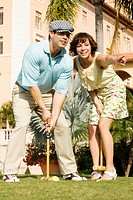 Couple playing croquet in a hotel lawn, Biltmore Hotel, Coral Gables, Florida, USA