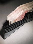 Fifty pound notes in a wallet