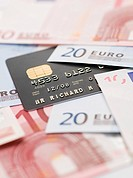 Credit card and euro banknotes