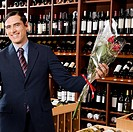 Businessman holding a bouquet of flowers