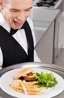 Close_up of a waiter holding a tray of snacks
