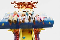 Low angle view of boys and girls on an amusement park ride