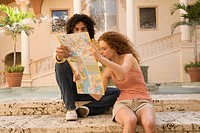 Couple looking at a map, Biltmore Hotel, Coral Gables, Florida, USA