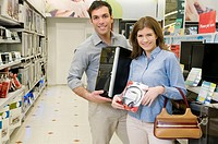 Couple buying CPU and headphones in a supermarket