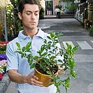 Customer holding a potted plant