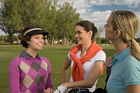 Three golfers standing in a golf course and smiling, Biltmore Golf Course, Coral Gables, Florida, USA