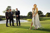 Bride playing golf and three men watching her, Biltmore Golf Course, Coral Gables, Florida, USA