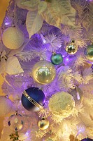 Close_up of a silver, blue and white Christmas tree