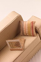 Sofa with cushions and a book made out of cardboard