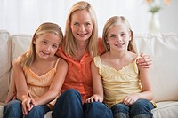 Mother and daughters at home