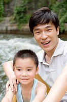 Man and little boy playing near the river and smiling, Family, Leisure Activities