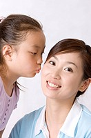 Little girl kissing on young woman´s face with smile, Family, Leisure Activities