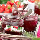 Jars with strawberry jam