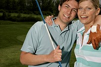 Young couple embracing on golf course