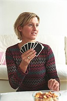 Woman holding Playing Cards (thumbnail)
