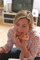 Blonde Woman eating Pizza