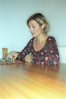 Woman playing a Board Game