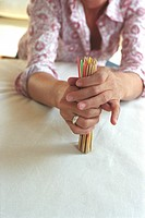 Woman holding Jackstraws Detail