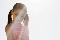 Portrait of little girl standing in sunlight