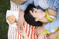 Young couple lying on blanket