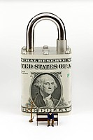 Paper padlock made from us dollar banknote with business doll