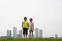 Young couple and city skyline