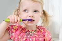 Little girl brushing her teeth (thumbnail)