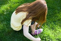 Girl tying shoelace