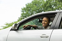 Smiling young man driving