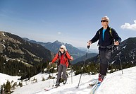 senior couple on ski tour in mountains