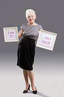 Senior woman with signs (thumbnail)