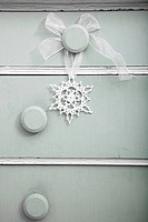 Snowflake decoration on dresser