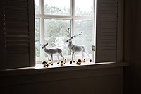 Reindeer figurines on windowsill