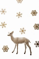 Deer figurine and snowflakes