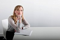 woman sitting with notepad