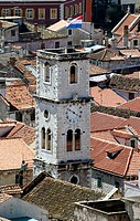 View to an old tower and the rooftops of the old quarter of Sibenik, Croatia, elevated view