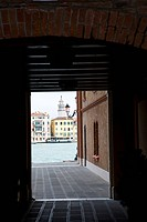 View through an entrance to a canal in Venice, Italy