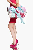 Woman with shopping basket full of gifts