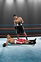 Boxer standing and opponent on floor