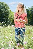 Girl in a field with flowers (thumbnail)