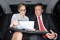 Business colleagues in the back of a car
