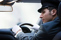 Male chauffeur driving