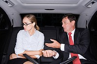 Businesspeople arguing in a car