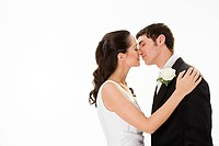Newlywed couple kissing (thumbnail)
