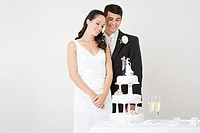 Newlyweds looking at a cake