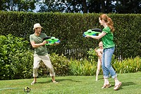 Family playing with water pistols