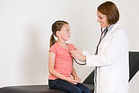 Girl and doctor with stethoscope
